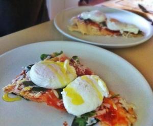 Sardinian breakfast. Tomato passata, parmesan, basil, pane di musica, poached eggs